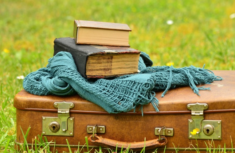 books and suitcase